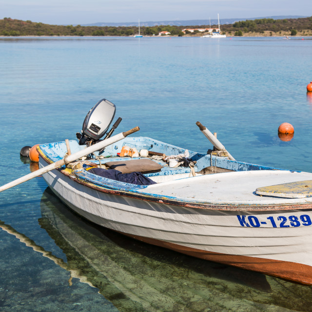 """""""Fishing boat in the shallow waters"""" stock image"""