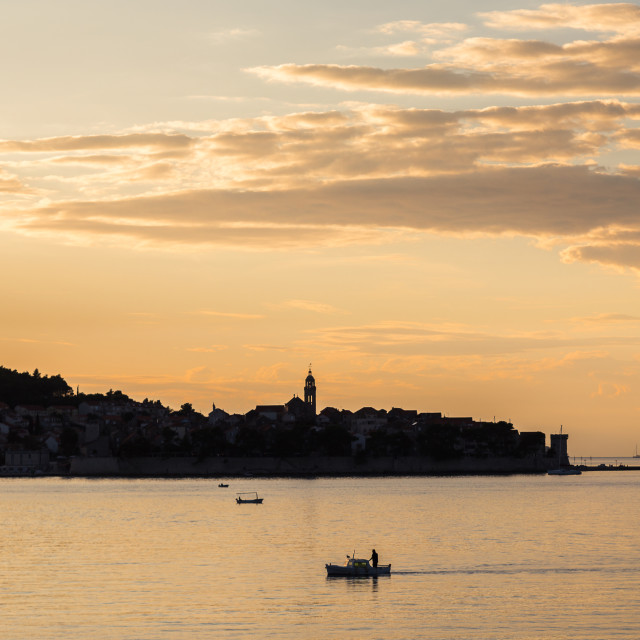 """""""Fisherman in front of Korcula old town"""" stock image"""