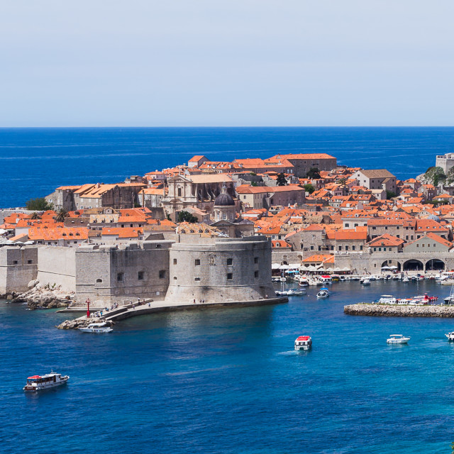 """""""Boats moving around Dubrovnik harbour"""" stock image"""