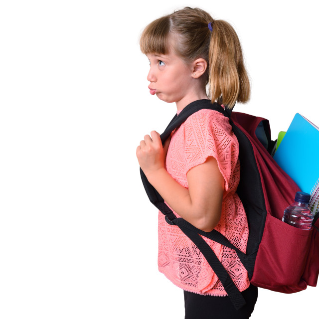 """""""Unmotivated little girl with backpack with school supplies isolated"""" stock image"""