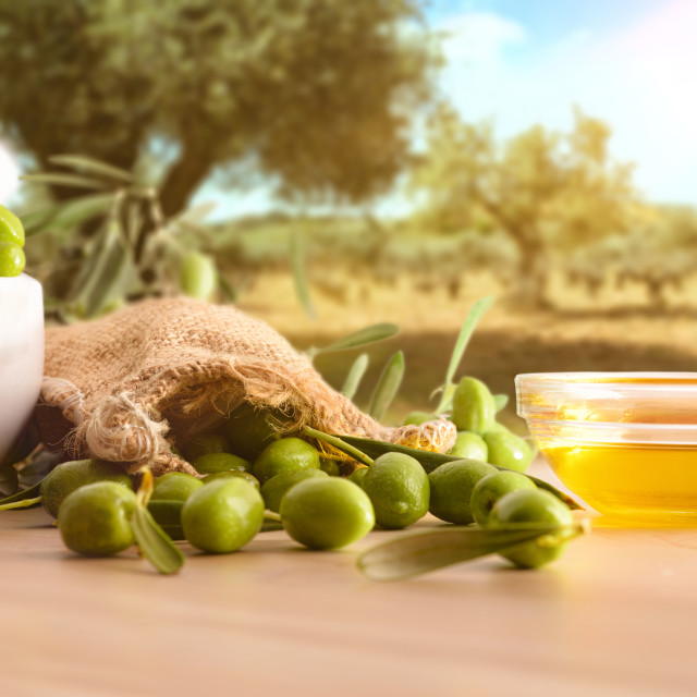"""""""Olive oil essence for body care on table in nature"""" stock image"""