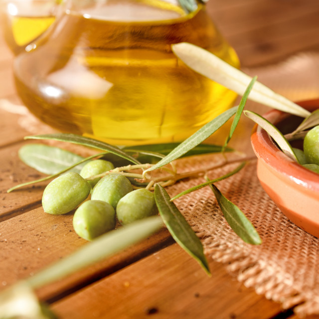 """""""Olives freshly picked on a wooden table with oil detail"""" stock image"""