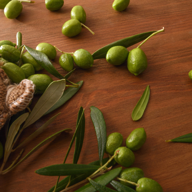 """""""Sack of harvest raw olives on wooden table top"""" stock image"""
