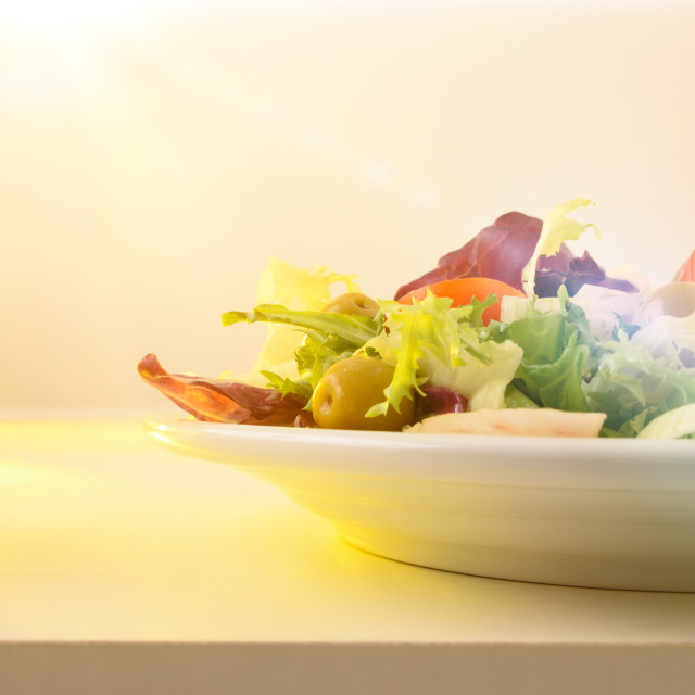 """""""Salad prepared on a plate dressed with olive oil isolated"""" stock image"""