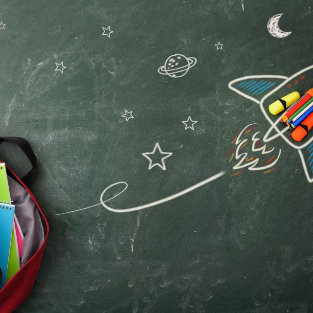 """School creativity with rocket drawing on blackboard with school supplies"" stock image"