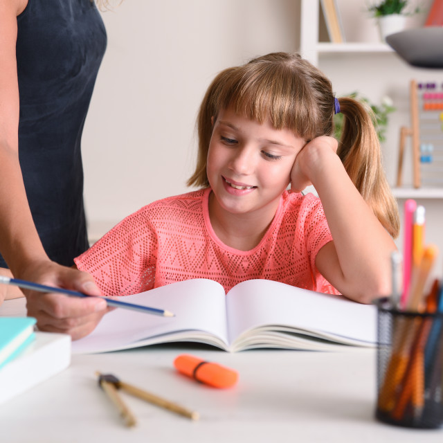 """""""Girl studying at home with teacher"""" stock image"""