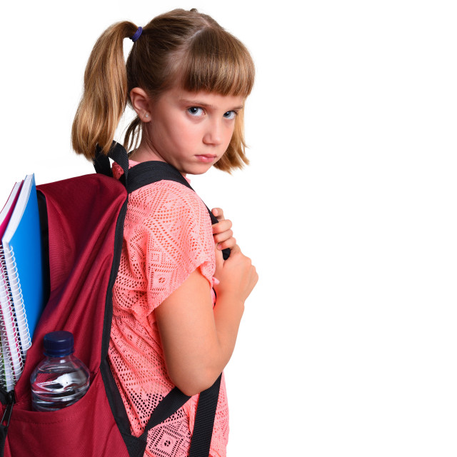 """""""Little girl with backpack with school supplies sad isolated"""" stock image"""