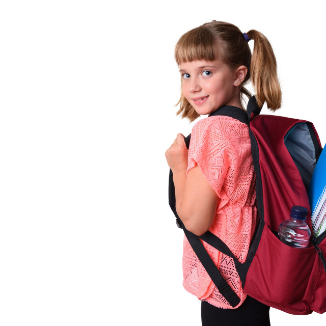 """""""Little girl with backpack with school supplies smiling isolated"""" stock image"""