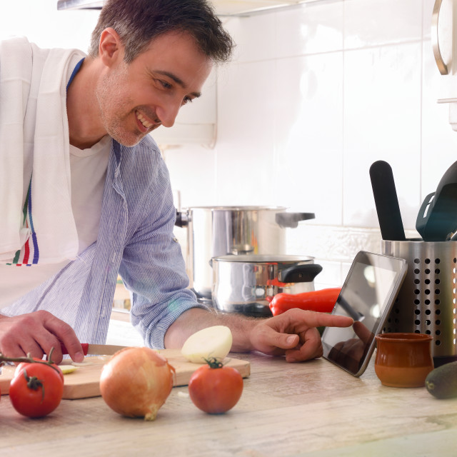 """""""Man using a tablet to prepare a dish"""" stock image"""