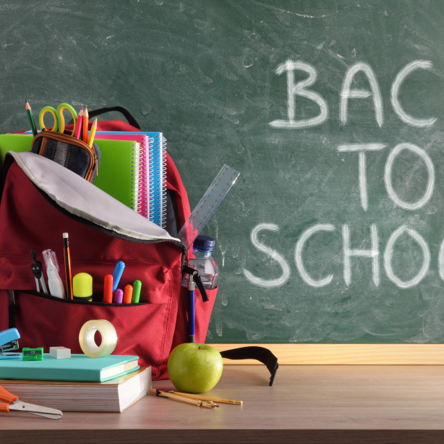 """""""Backpack on table and blackboard with back to school background"""" stock image"""