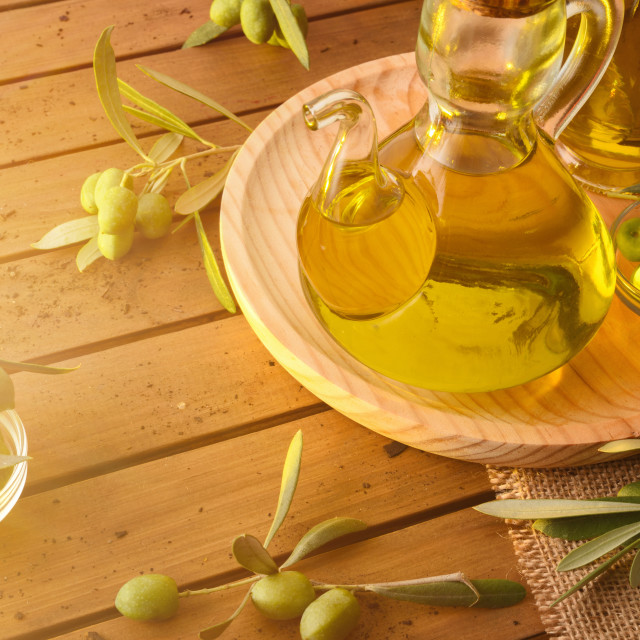"""""""Homemade new harvest olive oil in container on wooden table"""" stock image"""