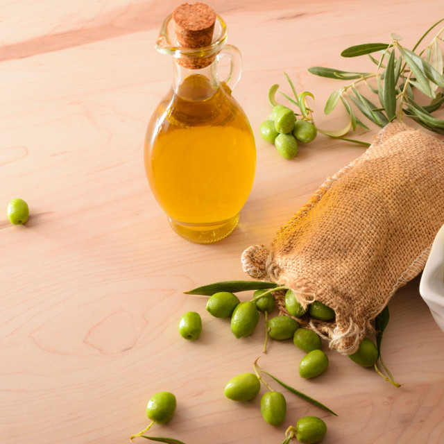 """""""Olive oil and sack with raw olives elevated view"""" stock image"""