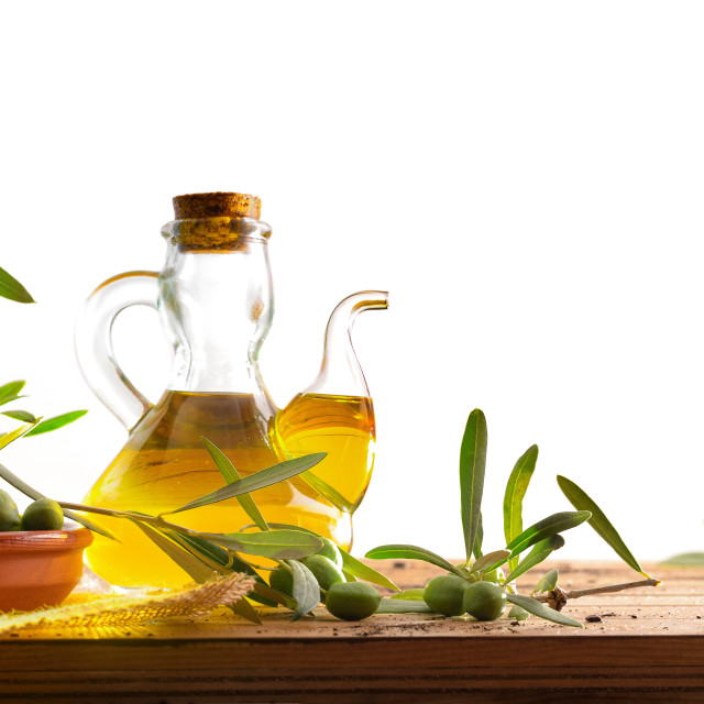 """""""Olive oil on wooden table with olives and leaves isolated"""" stock image"""