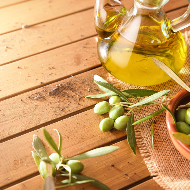 """""""Olives freshly picked on a wooden table with oil"""" stock image"""