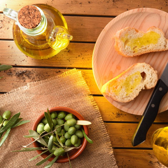 """""""Slices of bread with oil on wooden table in countryside"""" stock image"""