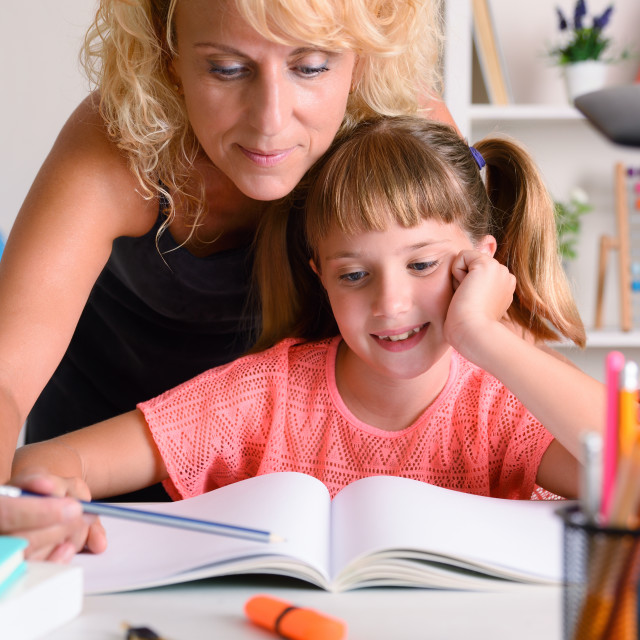 """""""Mother helping her daughter to study at home"""" stock image"""