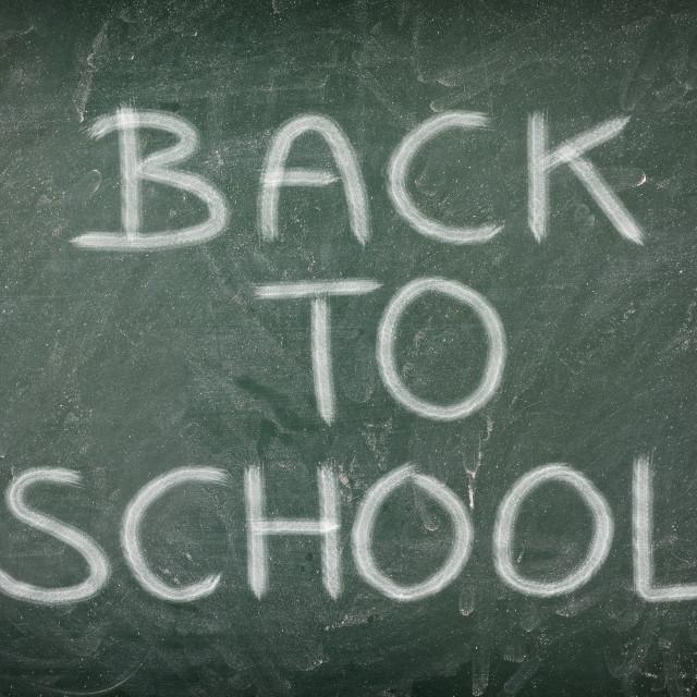 """back to school message on green blackboard"" stock image"