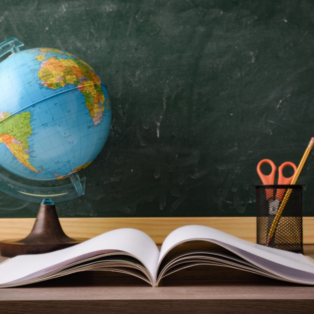 """""""Book on classroom desk with blackboard background"""" stock image"""