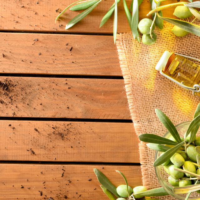 """""""Bottle with oil and container with olives on table top"""" stock image"""