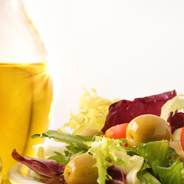 """""""Detail of salad dressed with olive oil white isolated background"""" stock image"""