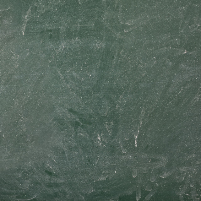 """Erased and dirty green college blackboard with space to write"" stock image"