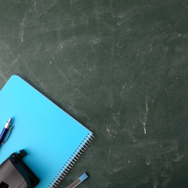"""Office supplies on green blackboard top view"" stock image"
