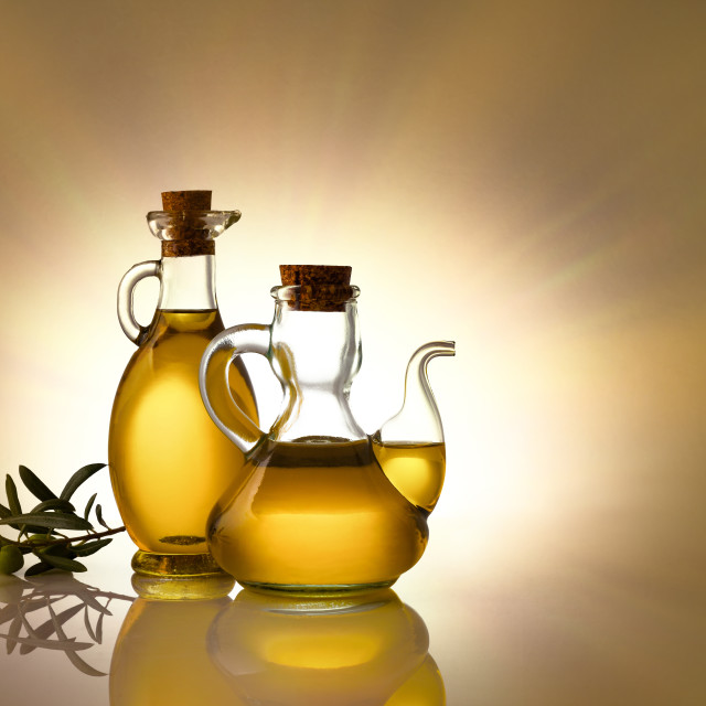 """Two bottles with olive oil isolated background"" stock image"