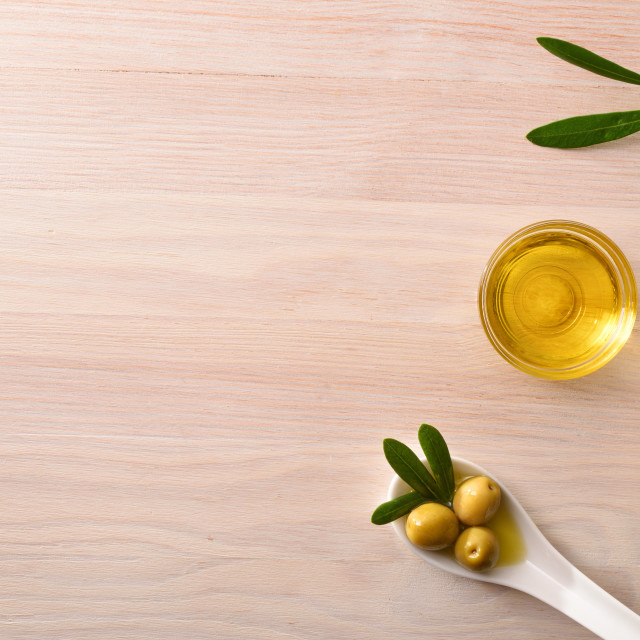 """Vegetable olive oil in glass bowls on kitchen bench top"" stock image"