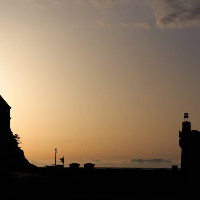 """""""Lynmouth harbour and tower silhouette at sunset."""" stock image"""