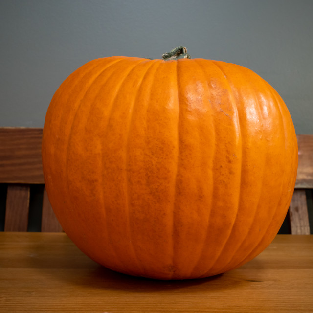 """A Pumpkin on a Wooden Table"" stock image"