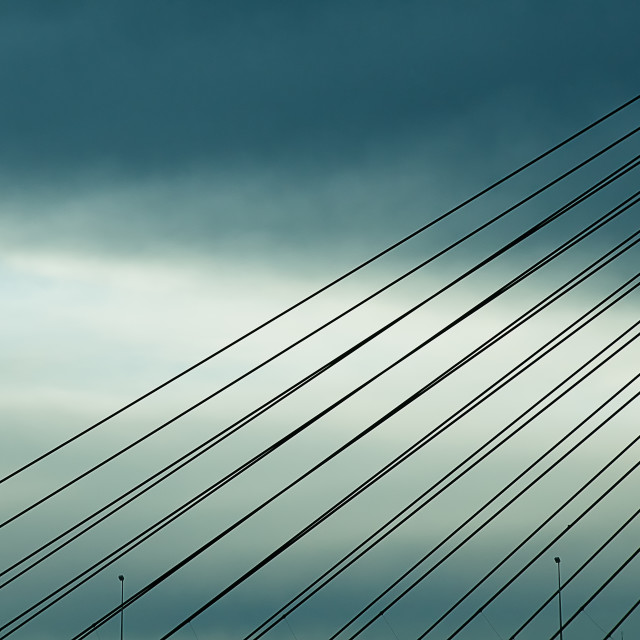 """Abstract image of cables on a cable road bridge with dramatic sky"" stock image"