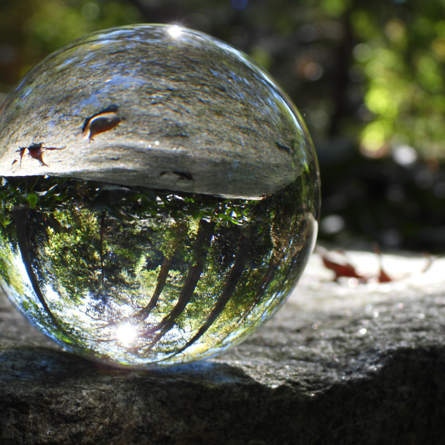 """Crystal Ball on Stone Bench"" stock image"