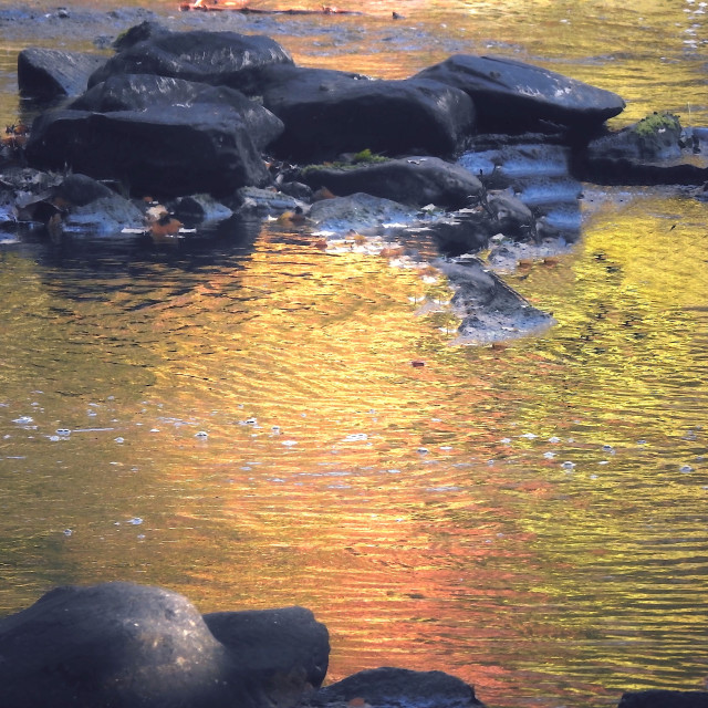 """Island of Rocks in an Orange River"" stock image"