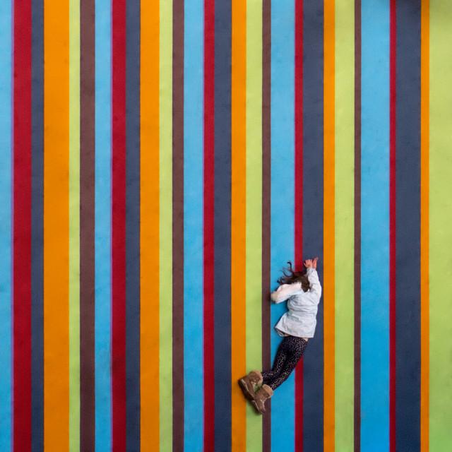 """Child among the Stripes"" stock image"