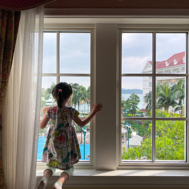 """Girl at a Window"" stock image"
