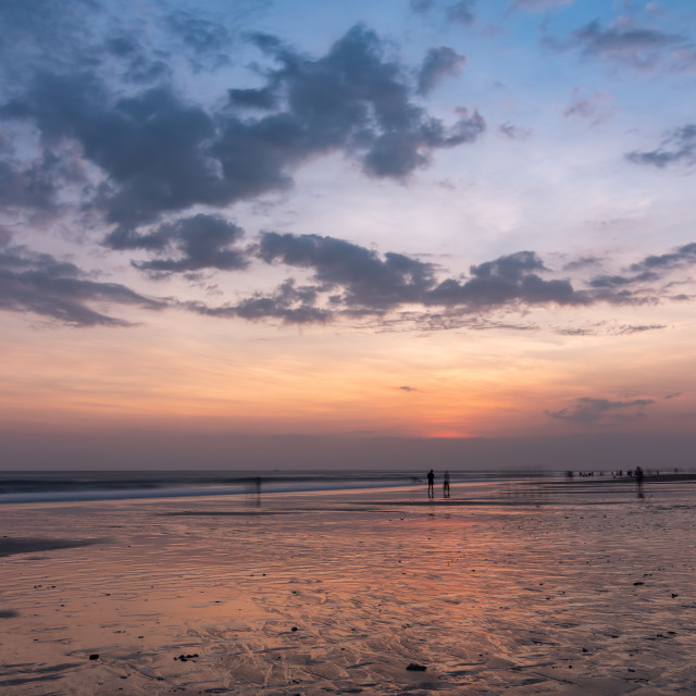 """From day to night // Seminyak Beach, Bali"" stock image"