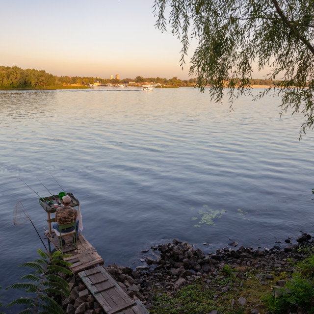 """Fisherman on the Dnieper River in Kiev, Ukraine"" stock image"