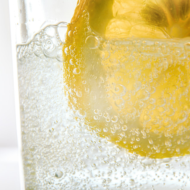 """Glass with sparkling water and lemon slice"" stock image"