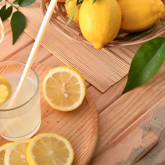 """Lemonade in glass on wood with lemons in beach resort"" stock image"