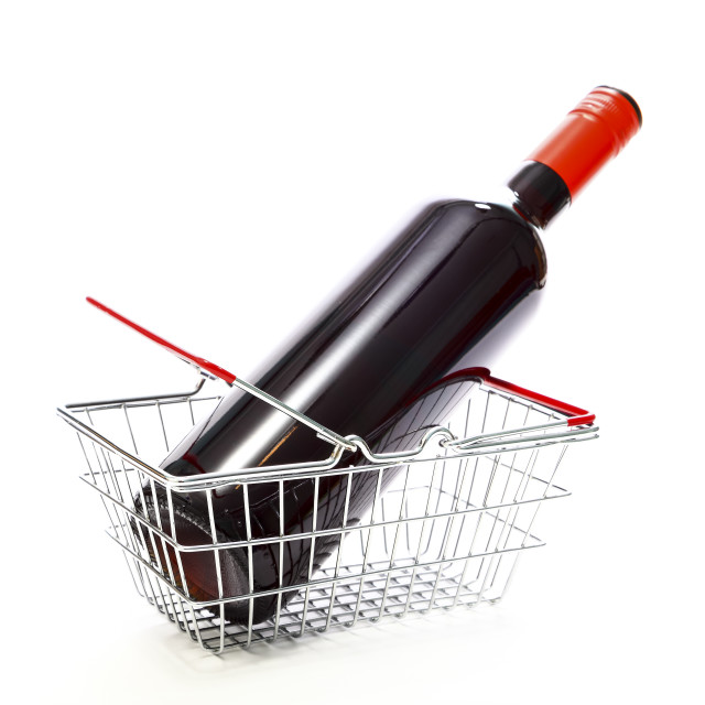 """""""Miniature wire shopping basket with a bottle of red wine isolated on a white background"""" stock image"""