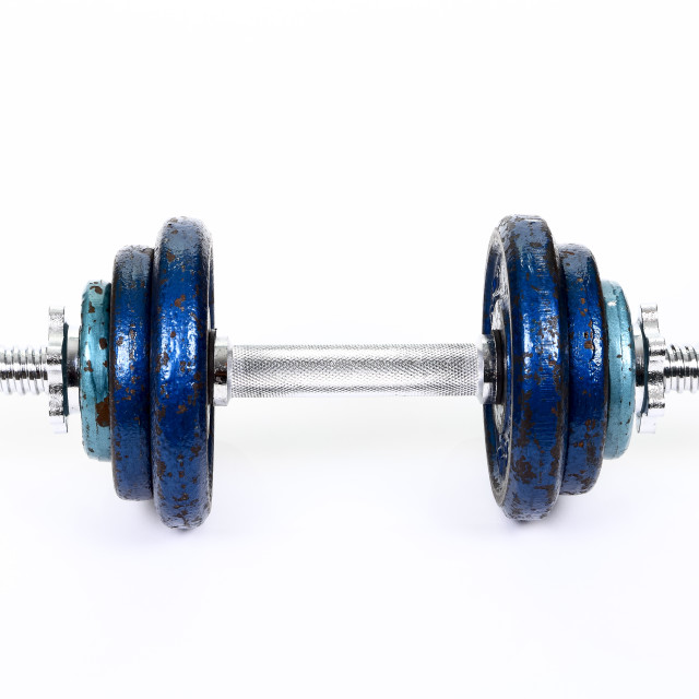 """Cast iron weights on a spinlock dumbbell bar"" stock image"