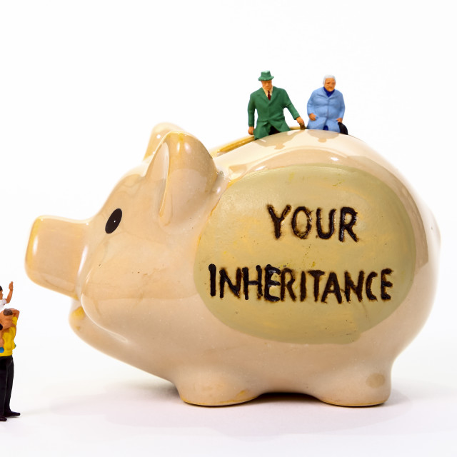 """Conceptual image of miniature figure pensioners sat on a piggy bank with the words Your Inheritance"" stock image"