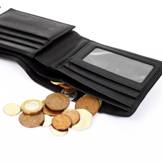 """Poverty concept with only loose change left in a leather wallet"" stock image"