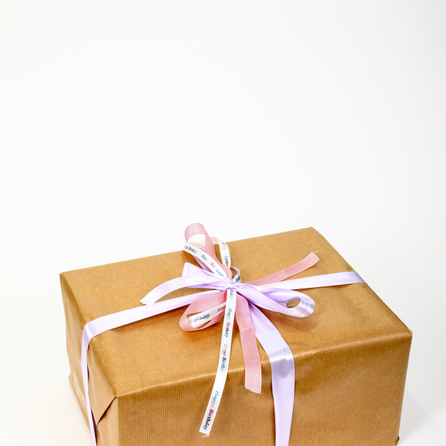 """Birthday gift wrapped in simple brown paper"" stock image"