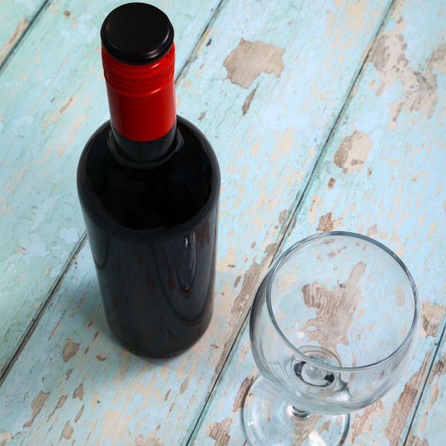 """Bottle of red wine and an empty wine glass"" stock image"