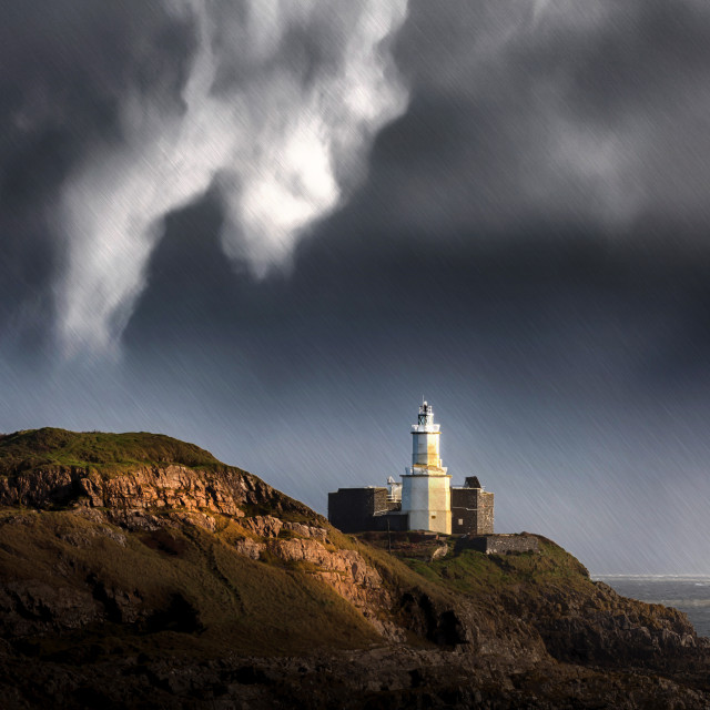 """""""Mumbles lighthouse in the rain"""" stock image"""