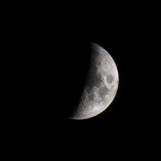 """A Waxing Crescent Moon, 42.7 visable. Picture taken 22/10/20 from Cambridge UK."" stock image"