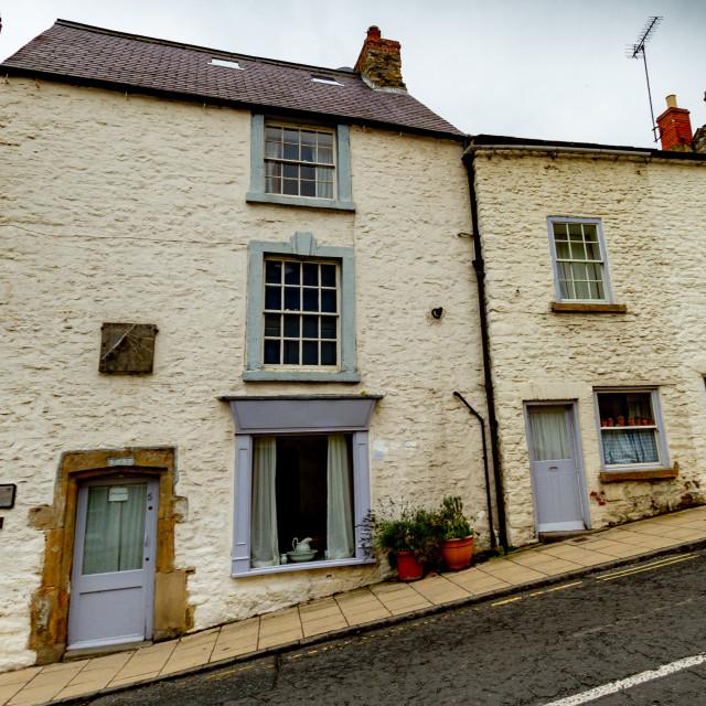 """Richmond, Yorkshire, Bridge Street, East Sundial and Plaque. Sundial Shop."" stock image"