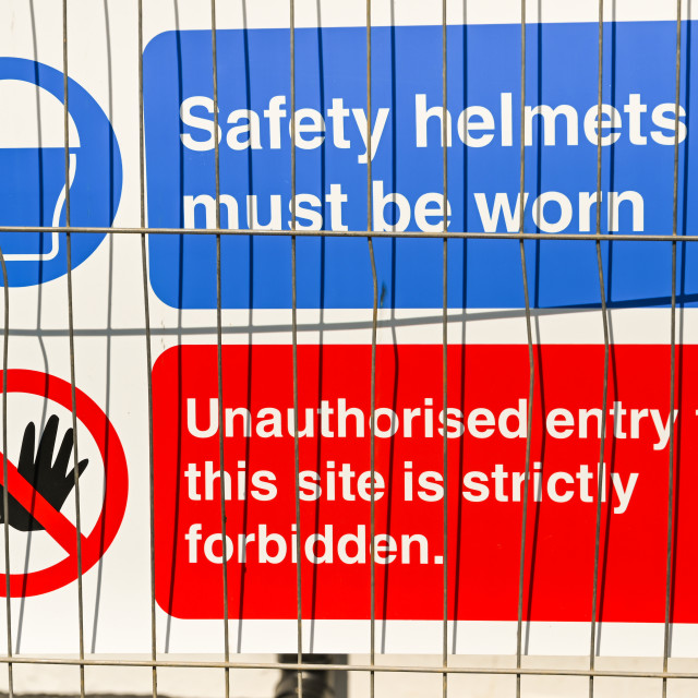 """""""Safety signs on a wire fence around a construction site"""" stock image"""