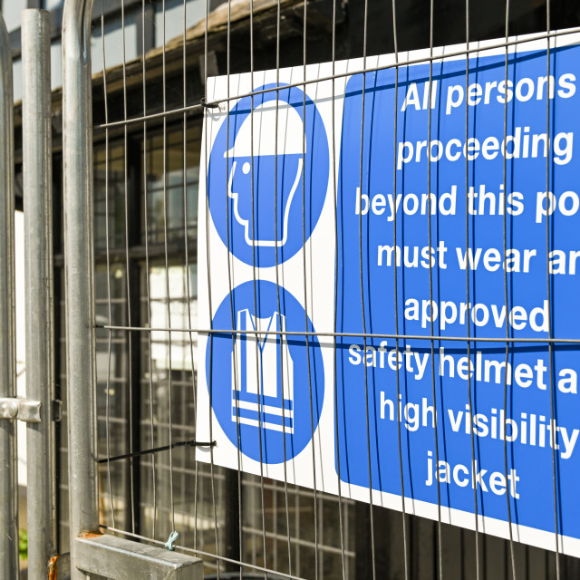 """""""Safety sign on a wire fence around a construction site"""" stock image"""